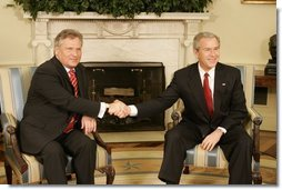 President George W. Bush welcomes Poland's President Aleksander Kwasniewski to the Oval Office Wednesday, Feb. 9, 2005. During their visit, President Kwasniewski spoke about the optimism of his government regarding the future of Iraq.  White House photo by Eric Draper