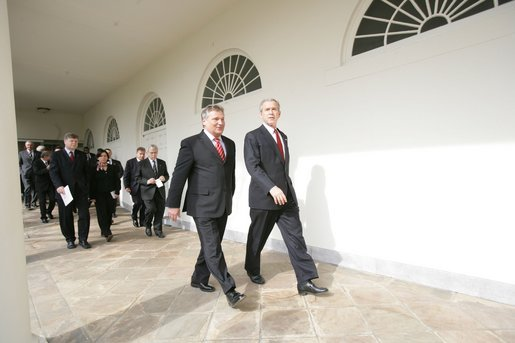 President George W. Bush and Aleksander Kwasniewski, the President of Poland, walk along the colonnade to the Oval Office Wednesday, Feb. 9, 2005. White House photo by Eric Draper