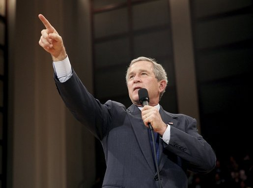 President George W. Bush acknowledges members of the audience during his Town Hall meeting on strengthening Social Security in Raleigh, N.C., Thursday, Feb. 10, 2005. White House photo by Eric Draper