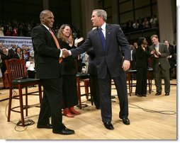 President George W. Bush greets his fellow stage participants during a Town Hall meeting on strengthening Social Security in Raleigh, N.C., Thursday, Feb. 10, 2005.  White House photo by Eric Draper