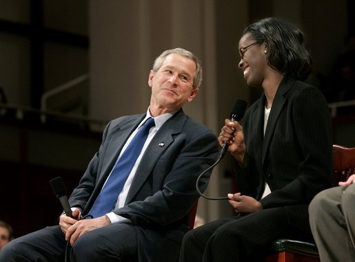 President George W. Bush and Dawn Baldwin, an English teacher at Lenior Community College in Kinston, N.C., exchange smiles during a town hall meeting on strengthening Social Security in Raleigh, N.C., Thursday, Feb. 10, 2005. White House photo by Eric Draper
