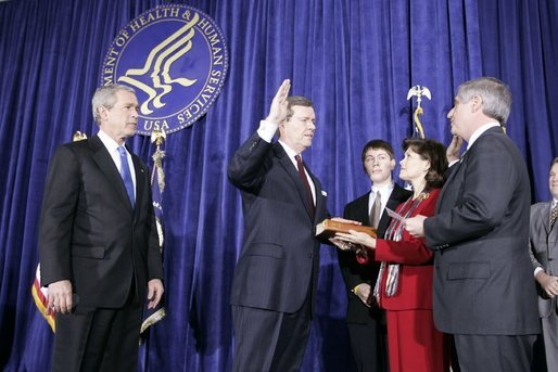 As President George W. Bush looks on, Mike Leavitt is sworn into office as Secretary of Health and Human Services by Chief of Staff Andrew Card. With Mr. Leavitt are his wife, Jackie, and son, Westin. The ceremony took place in the Great Hall at the U.S. Department of Health and Human Services. White House photo by Paul Morse.