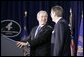 President George W. Bush shares a laugh with Mike Leavitt, newly sworn-in Secretary of Health and Human Services. Secretary Leavitt received the oath of office during ceremonies Friday. White House photo by Paul Morse.