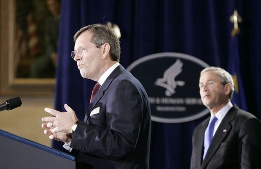 Mike Leavitt, newly sworn-in Secretary of Health and Human Services, addresses the audience after receiving the oath of office during ceremonies Friday, Feb.11, 2005, in the Great Hall at the U.S. Department of Health and Human Services. President George W. Bush looks on after introducing Secretary Leavitt. White House photo by Paul Morse.