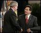Attorney General Alberto Gonzales receives congratulations from President Bush during ceremonies Monday, Feb. 14, 2005, marking Mr. Gonzales's new post. White House photo by Paul Morse