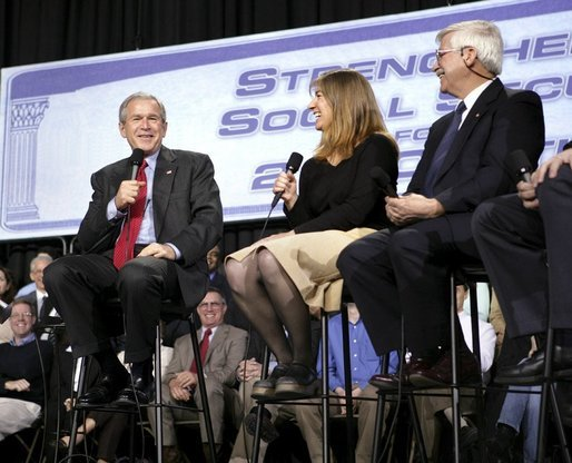 President George W. Bush shares a laugh with stage participants Frank Partin, right, and his daughter Amy during a Conversation on Strengthening Social Security at the Pease International Tradeport Airport, Wednesday, Feb. 16, 2005. White House photo by Eric Draper