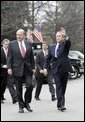 President George W. Bush walks with Ambassador John Negroponte, his nomination for the nation's first Director of National Intelligence, just outside the West Wing of the White House Thursday, Feb. 17, 2005. White House photo by Eric Draper