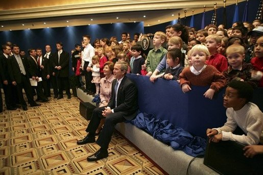 President George W. Bush and Laura Bush sit with children of embassy staff during their visit with U.S. Embassy employees Monday, Feb. 21, 2005, at the Sheraton Brussels Hotel and Towers in Brussels. White House photo by Eric Draper