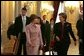 Laura Bush walks with Queen Paola of Belgium during a tour of the Royal Palace of Belgium in Brussels Monday, Feb. 21, 2005. White House photo by Susan Sterner