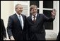 President George W. Bush and Belgian Prime Minister Guy Verhofstadt wave to the press outside the Prime Minister's office in Brussels, Belgium, Feb. 21, 2005. White House photo by Paul Morse