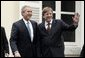 President George W. Bush and Belgian Prime Minister Guy Verhofstadt wave to the press outside the Prime Minister's office in Brussels, Belgium, Feb. 21, 2005. White House photo by Susan Sterner.