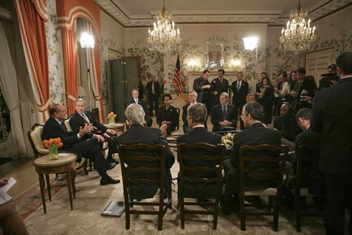 Attending a bilateral meeting, Presidents George W. Bush and Jacques Chirac of France address the press at the Ambassador's Residence, Brussels, Belgium, Monday, Feb. 21, 2005. White House photo by Eric Draper White House photo by Eric Draper.