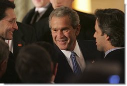 "President George W. Bush greets fellow leaders and audience members during his address at Concert Noble Ballroom in Brussels, Belgium, Monday, Feb. 21, 2005. ""In all these ways, our strong friendship is essential to peace and prosperity across the globe,"" said the President in his speech.   White House photo by Paul Morse"
