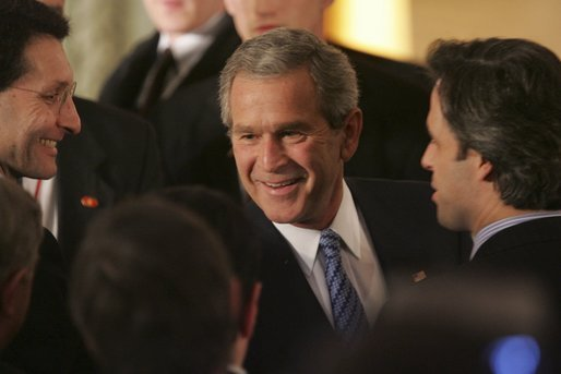 "President George W. Bush greets fellow leaders and audience members during his address at Concert Noble Ballroom in Brussels, Belgium, Monday, Feb. 21, 2005. ""In all these ways, our strong friendship is essential to peace and prosperity across the globe,"" said the President in his speech. White House photo by Paul Morse."
