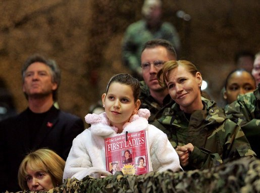 Audience members listen to a speech by Laura Bush praising the sacrifice and hard work of the U.S. military and their families Tuesday, Feb. 22, 2005 at Ramstein Air Base in Ramstein, Germany. White House photo by Susan Sterner