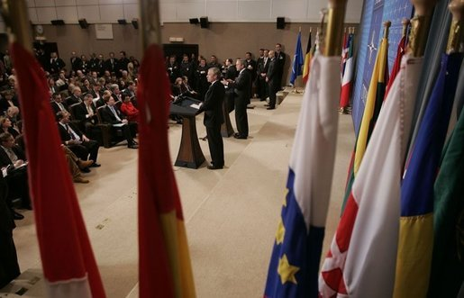 President George W. Bush and NATO Secretary General Jaap de Hoop Scheffer take questions during a news conference Tuesday, Feb. 22, 2005, at NATO Headquarters in Brussels. White House photo by Paul Morse