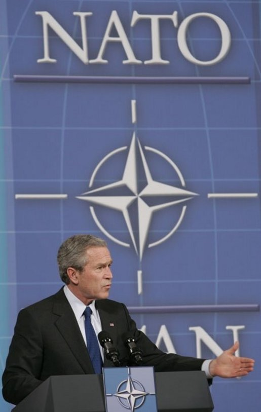 President George W. Bush speaks during a joint news conference with NATO Secretary General Jaap de Hoop Scheffer at NATO Headquarters in Brussels, Tuesday, Feb. 22, 2005. White House photo by Paul Morse