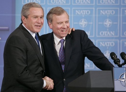 President George W. Bush is welcomed by NATO Secretary General Jaap de Hoop Scheffer during a news conference Tuesday, Feb. 22, 2005, at NATO Headquarters in Brussels. White House photo by Paul Morse