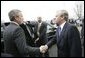 President George W. Bush shakes hands with Secretary General Jaap de Hoop Scheffer as he departs NATO headquarters in Brussels Tuesday, Feb. 22, 2005, at the conclusion of the NATO Summit. White House photo by Eric Draper