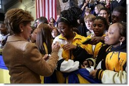 Laura Bush signs autographs for students of General H. H. Arnold High School following her remarks there to students, faculty and parents of the military in Wiesbaden, Germany, Tuesday, Feb. 22, 2005.   White House photo by Susan Sterner