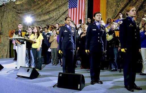 Students of General H. H. Arnold High School lead Mrs. Bush and the audience in the Pledge of Allegiance prior to her remarks Tuesday, Feb. 22, 2005, in Wiesbaden, Germany. White House photo by Susan Sterner