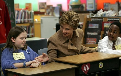 Mrs Bush greets Hainerberg Elementary School student Hailey Cook during her visit with fourth and fifth graders Tuesday, Feb. 22, 2005 in Wiesbaden, Germany. White House photo by Susan Sterner