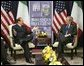 President George W. Bush meets with Prime Minister Silvio Berlusconi of Italy at NATO Headquarters in Brussels Tuesday, Feb. 22, 2005. White House photo by Eric Draper