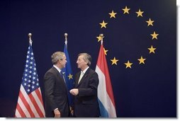 President George W. Bush meets with European Union President Jean-Claude Juncker while at the NATO Summit in Brussels Tuesday, Feb. 22, 2005.  White House photo by Paul Morse