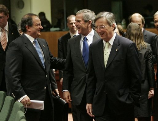 President George W. Bush laughs with Greek Prime Minister Costas Karamanlis, left, during a meeting at the European Union Council building in Brussels, Tuesday Feb. 22, 2005. White House photo by Eric Draper