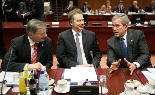 During a meeting with European Union Leaders at the EU Council Building in Brussels, President George W. Bush talks with Austrian Chancellor Wolfgang Schuessel, left, of Austria, and Prime Minister Blair of Britain,Tuesday, Feb. 22, 2005. White House photo by Eric Draper