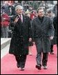 President George W. Bush and German Chancellor Gerhard Schroeder wave to the crowd during an official arrival ceremony at the Electoral Palace in Mainz, Germany, Wednesday, Feb. 23, 2005. White House photo by Eric Draper