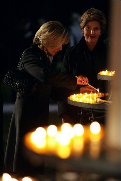 Laura Bush and Mrs. Schroeder-Koepf light candles during a tour of Saint Martin's Cathedral in Mainz, Germany, Feb. 23, 2005. White House photo by Susan Sterner