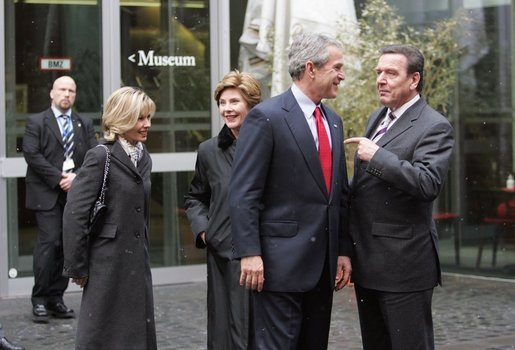 President George W. Bush, Laura Bush, German Chancellor Gerhard Schroeder, right, and Mrs. Schroeder-Koepf, left, visit before touring the Gutenberg Museum in Mainz, Germany, Feb. 23, 2005. White House photo by Susan Sterner