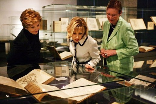 Laura Bush and Mrs. Schroeder-Koepf, center, view the Gutenberg Bible during a visit to the Gutenberg Museum in Mainz, Germany, Wednesday, Feb. 23, 2005. White House photo by Susan Sterner