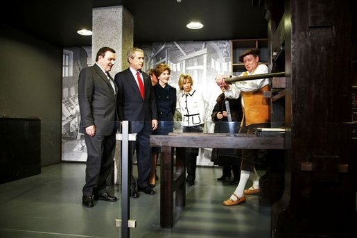 President George W. Bush, Laura Bush, German Chancellor Gerhard Schroeder, and Mrs. Schroeder-Koepf view the Gutenberg Press during a tour of the Gutenberg Museum in Mainz, Germany, Wednesday, Feb. 23, 2005. White House photo by Susan Sterner