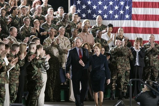 During a Feb. 23, 2005, visit to Wiesbaden Army Air Field in Wiesbaden, Germany, President George W. Bush and Laura Bush are welcomed by applause from U.S. troops. White House photo by Paul Morse
