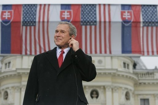 President George Bush listens to Slovak Prime Minister Mikulas Dzurinda's introduction before giving remarks at Hviezdoslavovo Square in Bratislava, Slovakia, Feb. 24, 2005. White House photo by Eric Draper