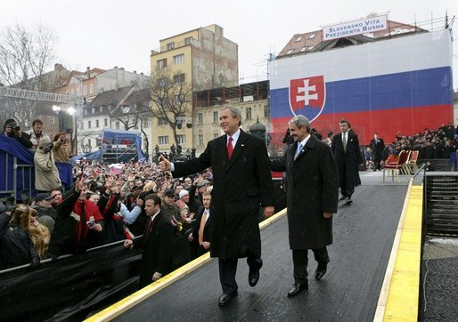 President George W. Bush gives his thumbs up as he leaves the stage with Prime Minister Mikulas Dzurinda of Slovakia after speaking at Hviezdoslavovo Square in Bratislava, Slovakia, Thursday, Feb. 24, 2005. White House photo by Eric Draper