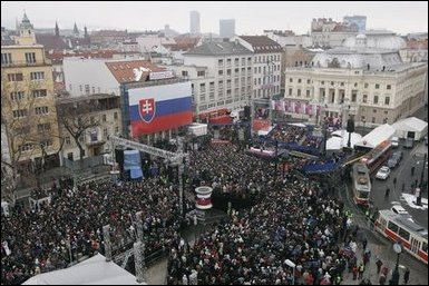 President George W. Bush and Slovakia's Prime Minister Mikulas Dzurinda are greeted by a crowd of thousands gathered in Bratislava's Hviezdoslavovo Square, February 24, 2005. White House photo by Paul Morse
