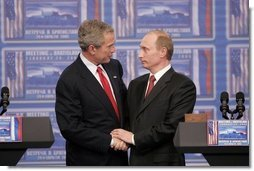 "President George W. Bush and Russian President Vladimir Putin clasp hands after a joint news conference Thursday, Feb. 24, 2005, in Bratislava, Slovakia. Said President Bush, ""I applaud President Putin for dealing with a country that is in transformation,"" adding, ""It's been hard work.""  White House photo by Paul Morse"