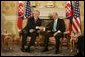 Prime Minister Mikulas Dzurinda of Slovakia welcomes President George W. Bush in Bratislava, Slovakia, February 24, 2005. White House photo by Eric Draper