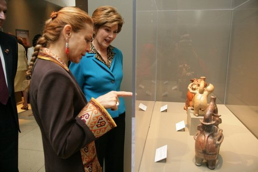 "Elaine Karp de Toledo, First Lady of Peru, explains artifacts on display to Laura Bush during a visit to view the exhibit ""Peru: Indigenous and Viceregal,"" at the National Geographic Society Friday, Feb. 25, 2005 in Washington, D.C. Also present is John Fahey, Jr., President and CEO of National Geographic Society. White House photo by Susan Sterner"