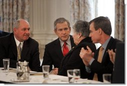 President George W. Bush talks with Governor Ruth Ann Minner, D-Del., during a meeting with the National Governors Association at the White House Monday, Feb. 28, 2005.  White House photo by Eric Draper