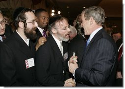 President George W. Bush greets attendees during a White House Faith-Based and Community Initiatives Leadership Conference in Washington, D.C., Tuesday, March 1, 2005.  White House photo by Paul Morse