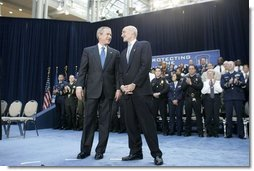 President George W. Bush stands with new U.S. Secretary of Homeland Security Michael Chertoff during Chertoff's swearing-in ceremony Thursday, Mar. 3, 2005, at the Ronald Reagan Building and International Trade Center in Washington, D.C.  White House photo by Paul Morse