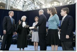 President George W. Bush watches as U.S. Supreme Court Justice Sandra Day O'Connor swears in Michael Chertoff as Secretary of Homeland Security during a ceremony Thursday, Mar. 3, 2005, at the Ronald Reagan Building and International Trade Center in Washington, D.C. On stage with Mr. Chertoff is his wife Meryl, center, and their two children Philip and Emily.  White House photo by Paul Morse