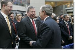 President George W. Bush greets former Attorney General John Ashcroft after the swearing-in ceremony Thursday, March 3, 2005, of Michael Chertoff as new Homeland Security chief. The event took place at the Ronald Reagan Building and International Trade Center in Washington, D.C.  White House photo by Paul Morse