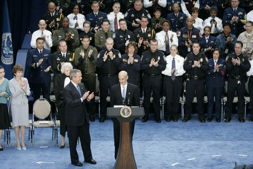 President George W. Bush and guests applaud Secretary Michael Chertoff after he was sworn in as the second Secretary of Homeland Security Thursday. Mar. 3, 2005. White House photo by Paul Morse