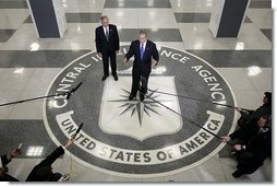 Standing on the agency seal, President George W. Bush speaks to the media inside the CIA headquarters Thursday, March 3, 2005, as CIA Director Porter Goss listens in.  White House photo by Paul Morse