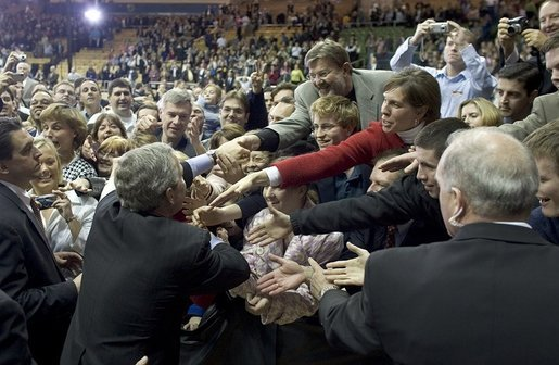 President George W. Bush greets the crowd after a conversation on strengthening Social Security on the University of Notre Dame campus in South Bend, Indiana on Friday, March 4, 2005. White House photo by Paul Morse